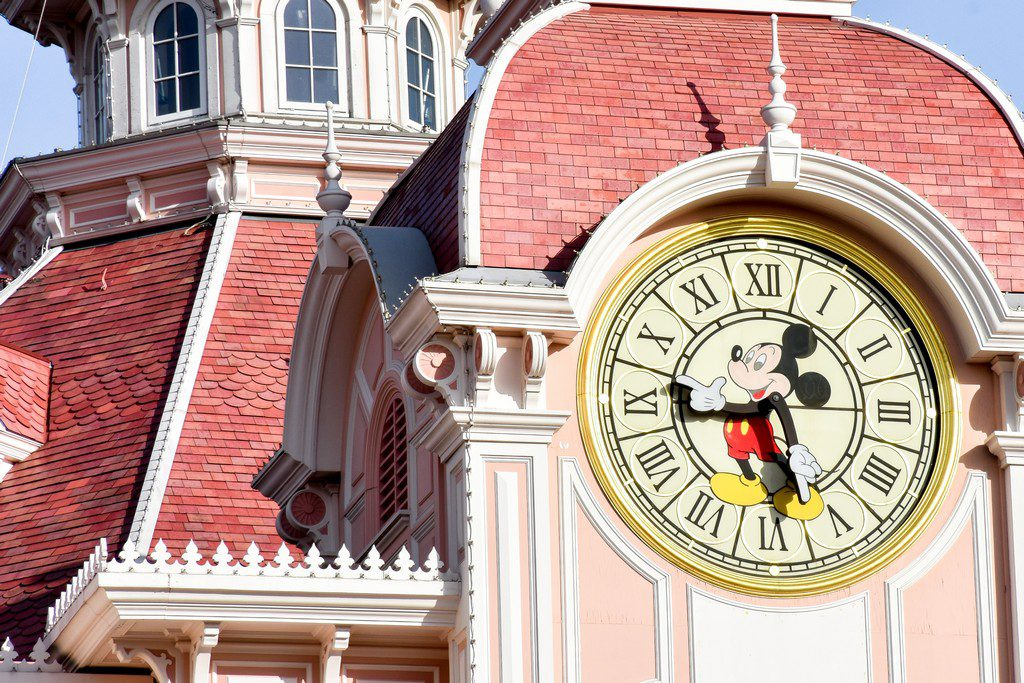 """<img src=""""clock.png"""" alt=""""mickey mouse clock on a building"""">"""