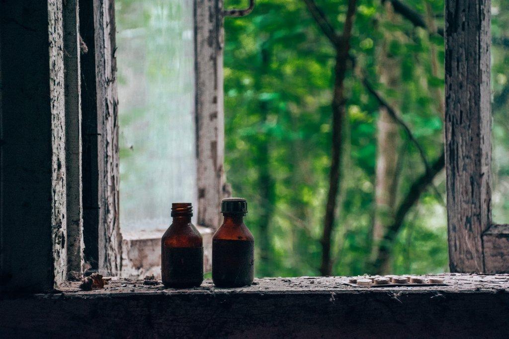 """<img src=""""old bottles.png"""" alt=""""old medication bottles on a window sill"""">"""