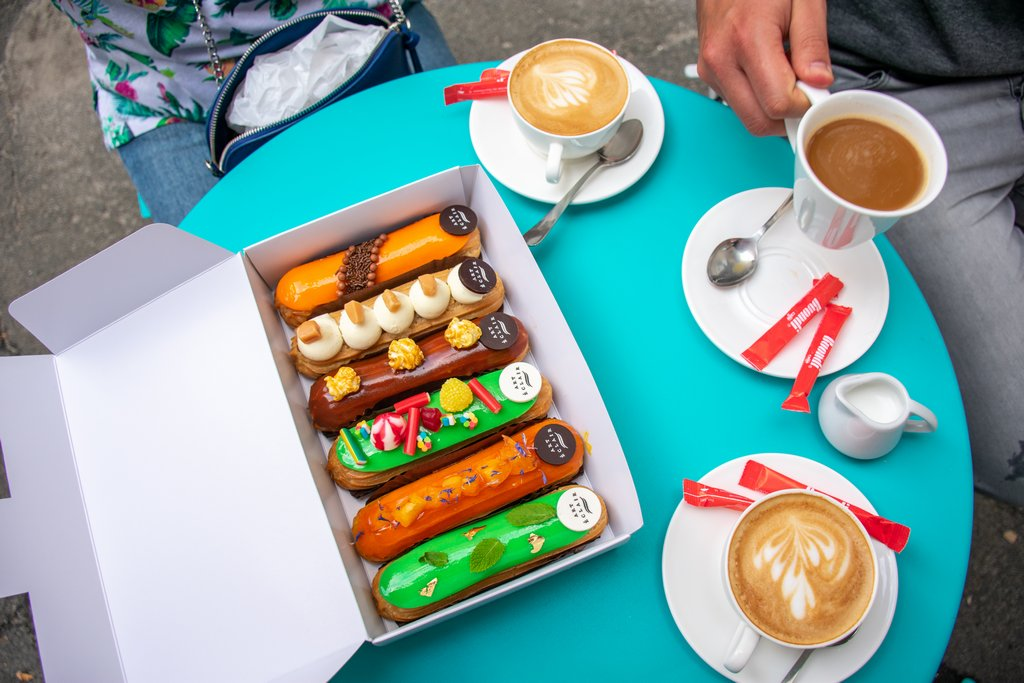 """<img src=""""eclairs.png"""" alt=""""a box of eclairs on a coffee shop table"""""""