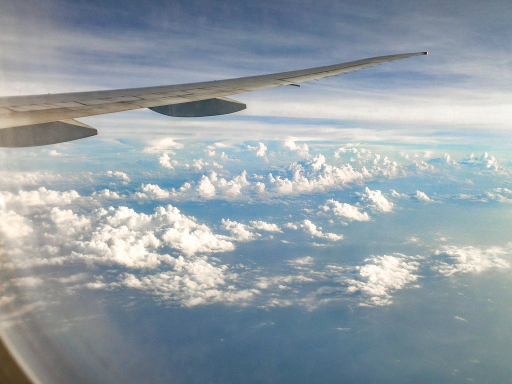 """<img src=""""clouds.gif"""" alt=""""view of clouds and a wing of a plane out of a plane's window"""">"""