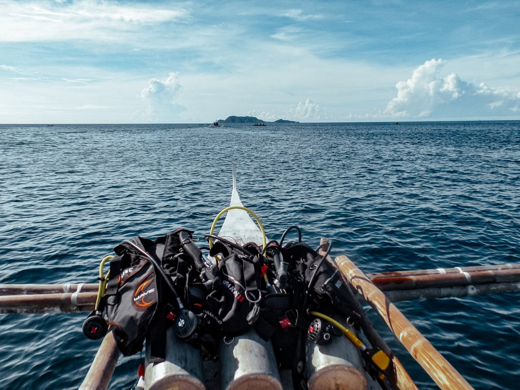"""<img src=""""diving equipment.gif"""" alt=diving equipment on the deck of a boat"""">"""