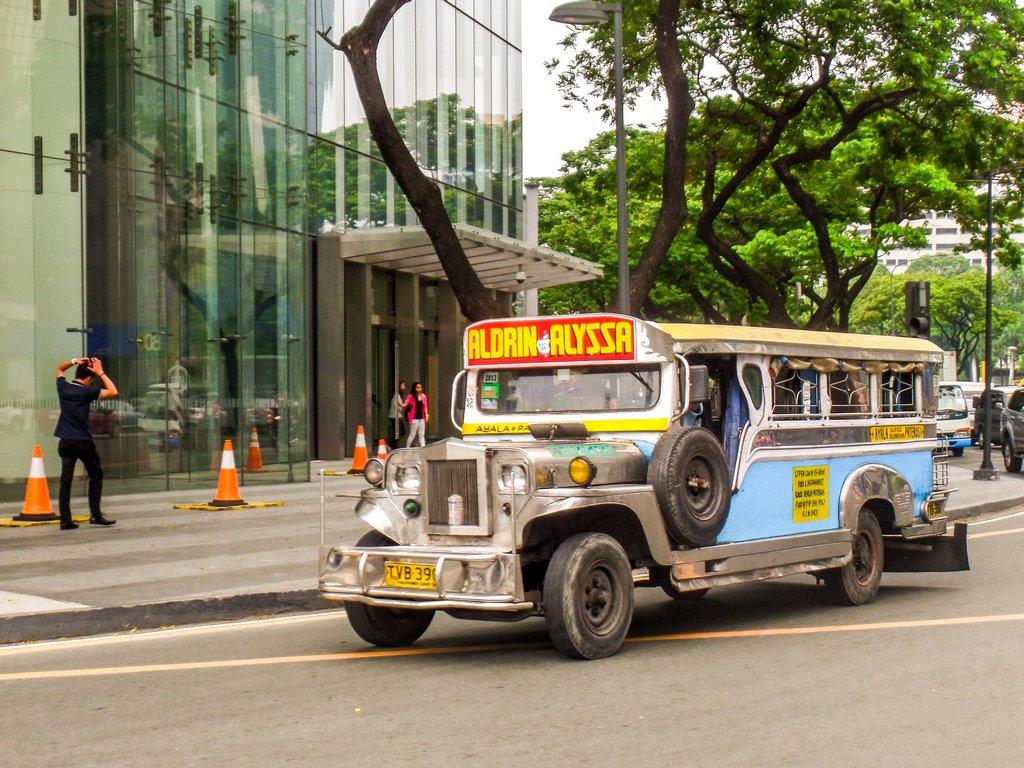 "<img src=""jeepney bus.gif"" alt=""jeepney bus on a road in Manila city"">"