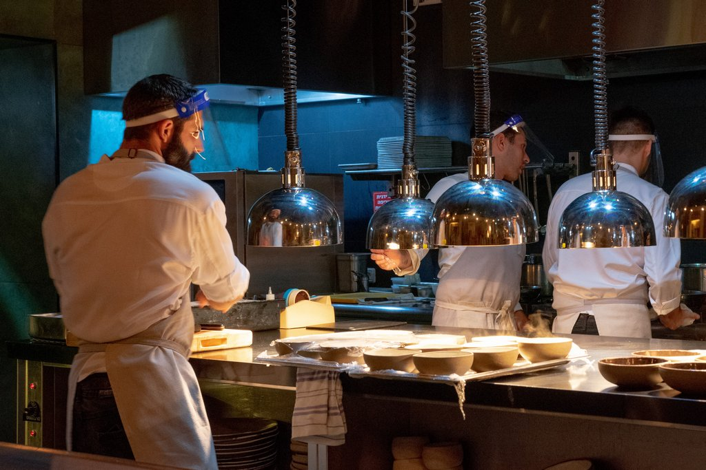 """<img src=""""a cook.png"""" alt=""""a cook at the OCD restaurant in Tel aviv"""">"""